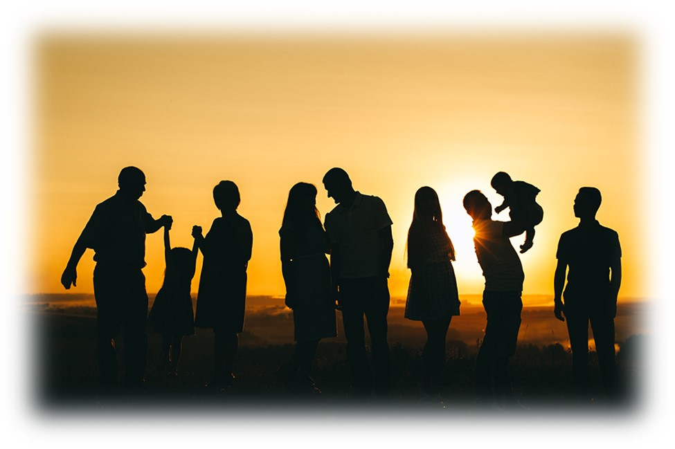 Silhouette of group of people at sunset